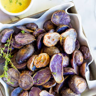 Roasted Purple Potatoes with Lemon, Dijon & Thyme Dressing.