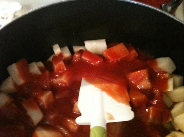 Add totomatoes sause and stir. Turn down flame to a simmer.
