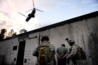Photo: U.S. military personnel prepare to board a U.S. Marine Corps CH-46 Sea Knight helicopter during exercise Emerald Warrior 2010 in Fort Walton Beach, Fla., March 11, 2010. The training is a U.S. Special Operations Command-sponsored mission rehearsal exercise involving multiservice participants. The exercise is conducted in multiple states and training sites throughout the southeast. (U.S. Air Force photo by Staff Sgt. Clay Lancaster/Released)