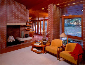 Photo: Frank Lloyd Wright designed with an eye toward uniformity. At the Zimmerman House in Manchester, New Hampshire, interior and exterior spaces flow together. The same autumnal colors are used throughout. Frank Lloyd Wright was known for using a brownish red he called Cherokee red. Made with iron oxide, Cherokee red was not one exact color but a whole range of reddish hues, some dark and some more vivid. In this photo, gold and red furnishings harmonize with colors of the woodwork and bricks.