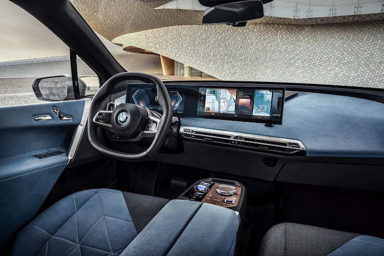 The minimalist interior has digital sophistication and a hexagonal steering wheel. Picture: SUPPLIED