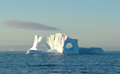 An iceberg disguised as a Phantom of the Opera mask seen during a sailing to Antarctica.