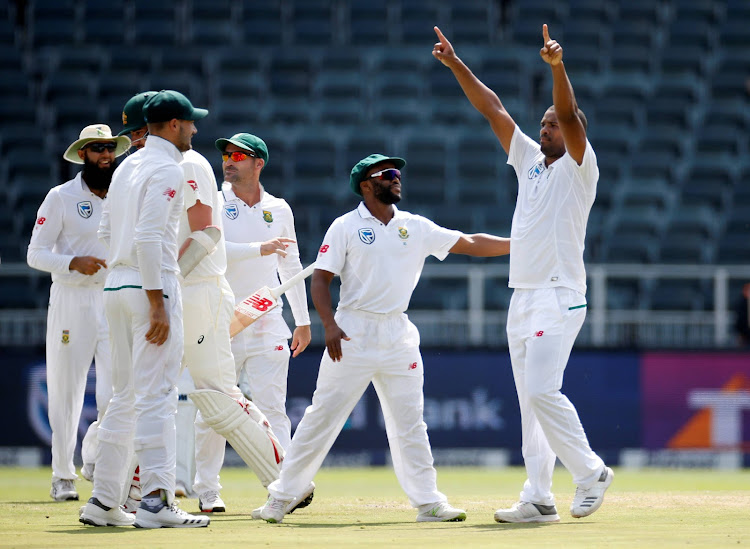 South Africa's Vernon Philander celebrates bowling out Australia's Chad Sayers with team mates.