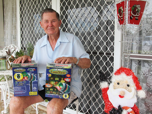 Arthur Wells with the replacement Christmas decorations for him and his neighbour, kindly donated by a Courier reader.