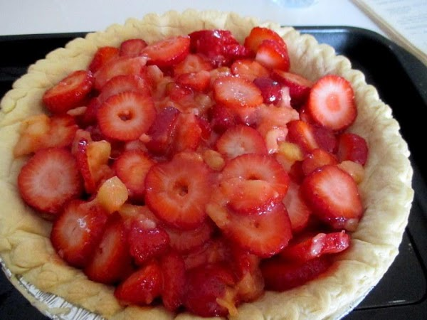 Evenly spread strawberry mixture into pie shell.