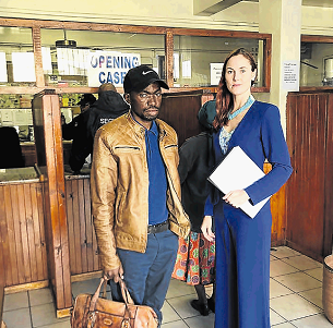 DA councillor Malibongwe Xhelisilo and DA MP Terri Stander open a case against municipal leaders at the Komani police station.
