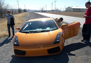Photo: Fitting one's self into the Gallardo. Perhaps easier to just lay down on the ground, then roll in.