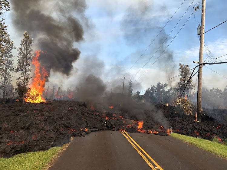 Lava advances along a street near a fissure in Leilani Estates, on Kilauea Volcano's lower East Rift Zone, Hawaii, the US, May 5 2018. Picture: US GEOLOGICAL SURVEY/REUTERS