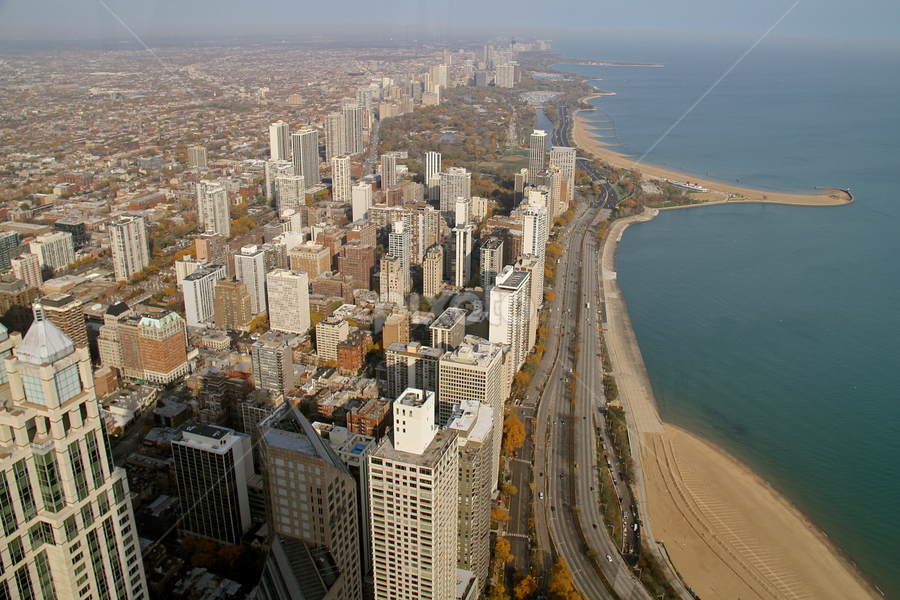 Chicago's Lake Michigan Shore by Leigh Thomson - City,  Street & Park  Vistas ( water, skyline, illinois, skyscrapers, beach. oak st, old town, travel, architecture, usa, city, urban, lake michigan, vista, buildings, chicago )