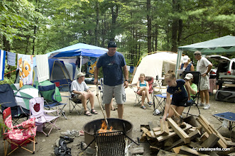 Photo: Kevin Higgins of South Glens Falls, NY, acts as the firemaster at the multi family campsite at Bomozeen State Park. Photo by Karen Pike