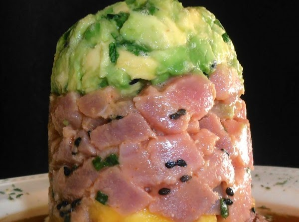 in 3-4 in round dish, add avocdado mixture, tuna and top with mango. ...