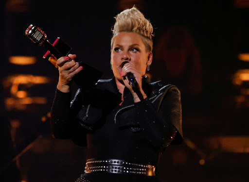 Pink fans stunned as singer & daughter Willow, 9, perform duet & soaring trapeze act at the Billboard Music Awards