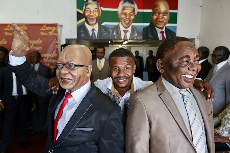 Lungelo Gumede with his sculptures of Jacob Zuma and Cyril Ramaphosa.