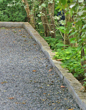 Photo: Limestone curbing contains this black granite gravel driveway and adds to it's formal look.