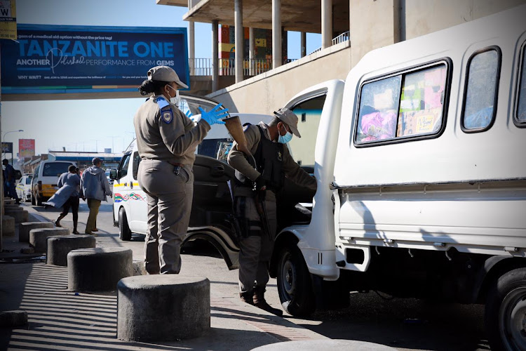 Police stop and search vehicles at the Baragwanath taxi rank during a patrol in Soweto on Thursday.
