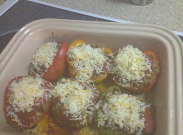 Remove the peppers from the oven. Put cheese on top and [lace back in...