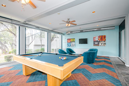 Clubhouse with tile flooring, lots of windows, billiards table, and area for lounging