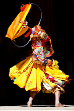 Photo: A traditional dancer at the Black Necked Crane Festival in the Gangtey Monastery at Phobjikha, Bhutan. This festival is held annually in celebration of the cranes as they arrive from their migration southwards from the Tibetan Plateau. The cranes stay in Phobjikha Valley for about 4 months before heading back north via a difficult flight over the Himalayas.