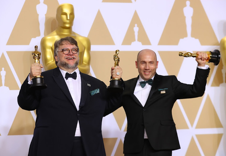 "Guillermo del Toro and J. Miles Dale after winning Best Picture and Best Director awards for ""The Shape of Water"" at the 90th Academy Awards on March 4 2018."