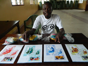Photo: Alfred Sigo preparing materials for a large community meeting http://koru.or.ke/BBN-Meeting-Jan-2013