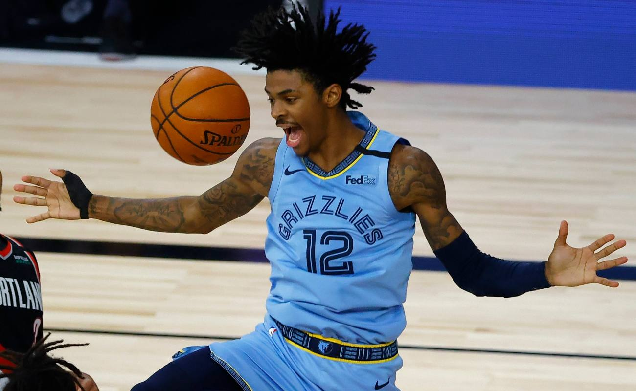 Ja Morant #12 of the Memphis Grizzlies reacts after a dunk against the Portland Trail Blazers during the fourth quarter in the Western Conference play-in game one at The Field House at ESPN Wide World Of Sports Complex on August 15, 2020 in Lake Buena Vista, Florida. (Photo by Kevin C. Cox/Getty Images)