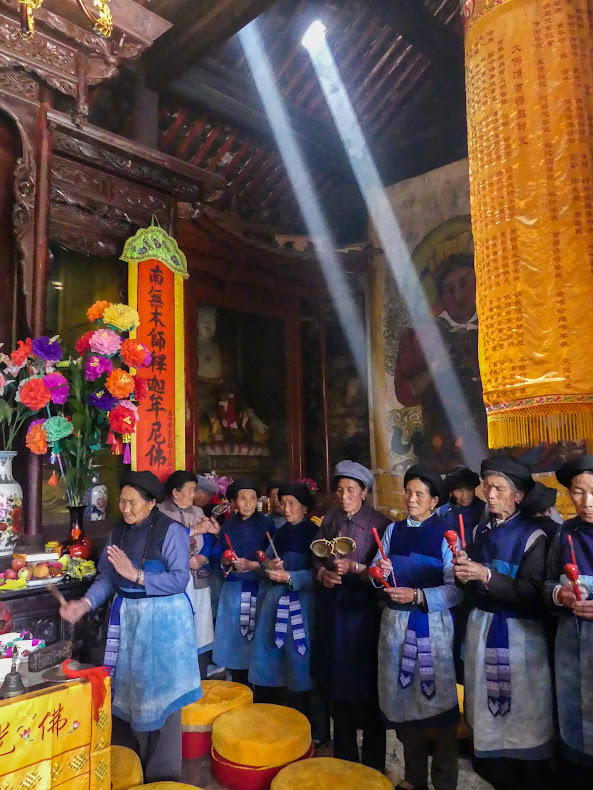 Bai women at Shaxi Shibaoshan Haiyun Nunnery ceremony - Shaxi tours by Old Theatre Inn