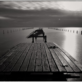 Broken! by Stig Johansson - Black & White Landscapes ( clouds, broken, water, black and white, beautiful, sea, long exposure, ocean, bridge, evening, sun )