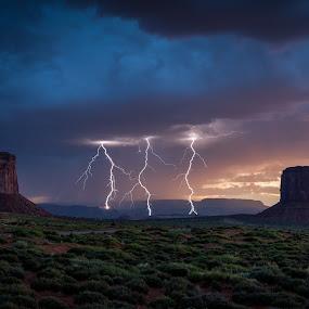 Monument Valley Lightning by Jeff Fahrenbruch - Landscapes Sunsets & Sunrises ( navajo, lightning, sunset, arizona, monument valley navajo tribal park )