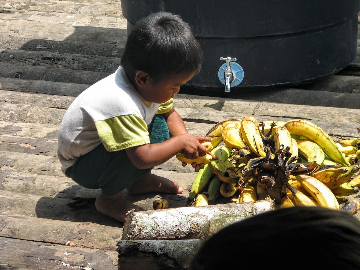 Kid grabbing a banana