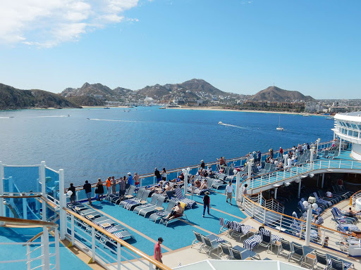 leaving-cabo - Passengers gather on the Lido deck of Ruby Princess as she departs from Cabo San Lucas, Mexico.