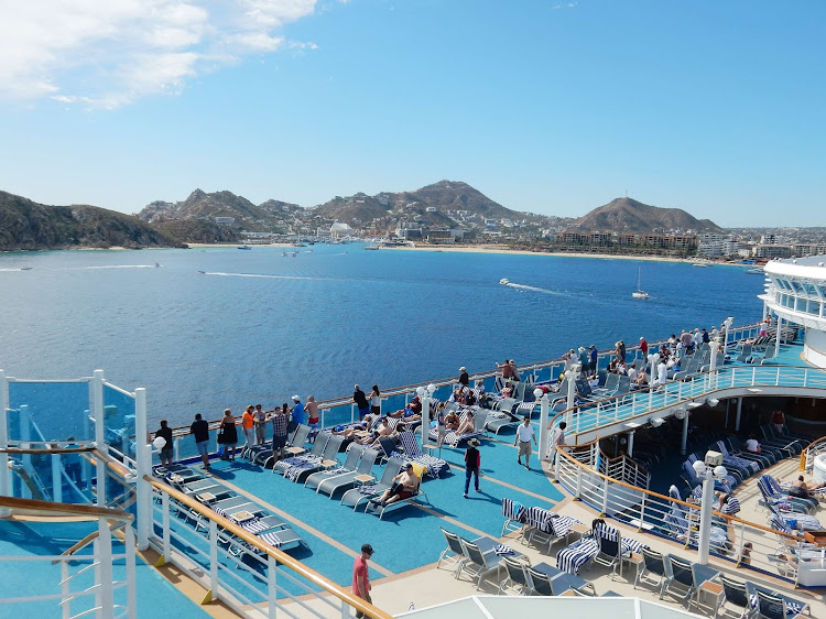Passengers gather on the Lido deck of Ruby Princess as she departs from Cabo San Lucas, Mexico.