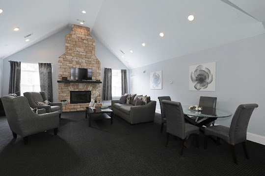 Community club house with two windows, tv, fireplace, and seating area