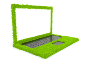 Photo: Green computer laptop of grass 3D. Isolated on white background