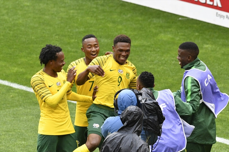 Bafana Bafana France-based striker Lebo Mothiba (#9) celebrates with teammates after scoring a goal in a 6-0 win during the 2019 Africa Cup of Nations qualification match between South Africa and Seychelles at FNB Stadium on October 13, 2018.