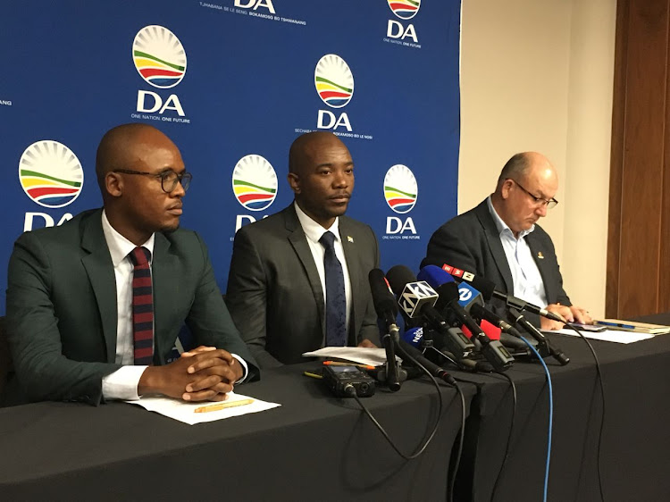 DA spokesperson Solly Malatsi' party leader Mmusi Maimane and ousted Nelson Mandela Bay mayor Athol Trollip at a press conference on August 28, 2018 in Cape Town.
