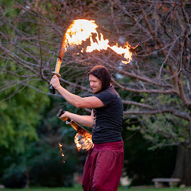 Spinning Flames by Duane Vosika - People Musicians & Entertainers ( #action, #male, #swords, #omaha, #performer, #nebraska, #fire, #nikon, #man, #entertainer, #flames, #people )