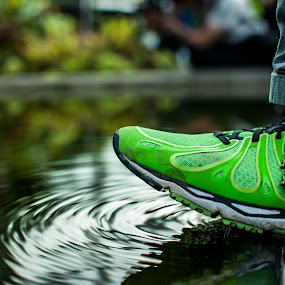 Ripples by Han Yi Li - Novices Only Abstract ( water, ripples, waves, still, gardens by the bay, shoe )