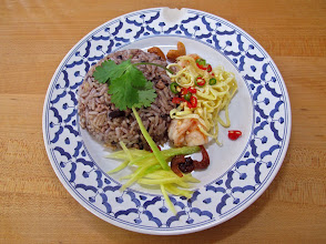Photo: a plate of salted black olive fried rice with accompaniments