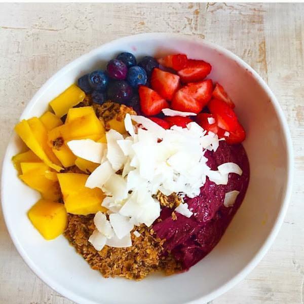 Acai Bowl with banana, house made granola, seasonal fruit, local honey and coconut flakes at Lilikoi Organic Living