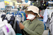 A customer at a Pep store wearing a protective face mask to protect herself from the coronavirus which has spread to more than 60 people in the country. /Thulani Mbele