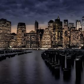 Manhattan night by Morten Golimo - City,  Street & Park  Skylines ( manhattan skyline, pier, long exposure, night, new york, morten golimo, poles )