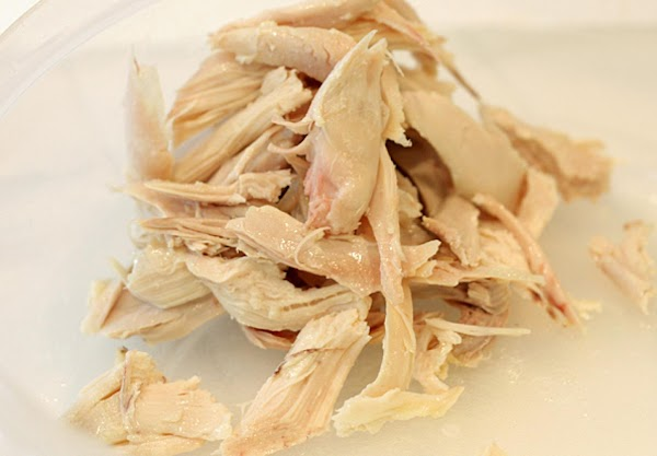 If you are using pre-cooked chicken (like the rotisserie chicken from the supermarket), pull...