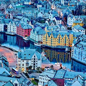 City of Alesund in Norway by Péter Mocsonoky - City,  Street & Park  Vistas ( port, illuminated, reflection, europe, street, cityscape, travel, architecture, house, landscape, coastline, panorama, coast, fjord, island, mountains, sky, alesund, nature, scandinavian, houses, scandinavia, art, beautiful, twilight, sea, tourism, scenic, urban, landmark, european, norwegian, blue, outdoors, background, summer, night, town, view, panoramic )