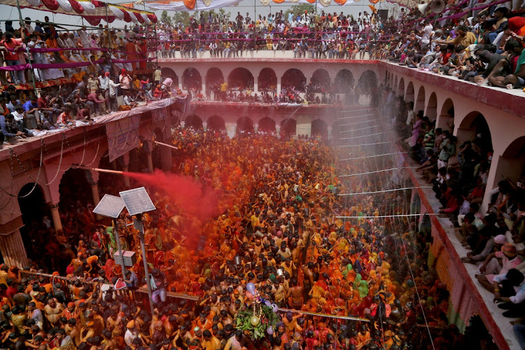 Hindu devotees take part in Huranga a day after Holi, the festival of colours, at Dauji temple near the northern city of Mathura, India, March 30 2021. Picture: REUTERS/KK ARORA