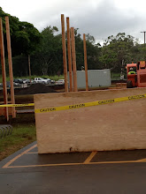 Photo: Putting up temporary barriers so workers can put the stakes in for the 12-foot dust screens