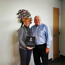 Photo: Robert and Diana Cataldo, owners of Cataldo Ambulance Service, Inc. with their 25 Year Accreditation Achievement Award Plaque