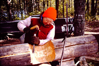 Photo: Lorraine notching a log.