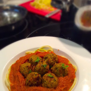 "Vegan hearty Italian ""meatballs"" in a rich tomato sauce"