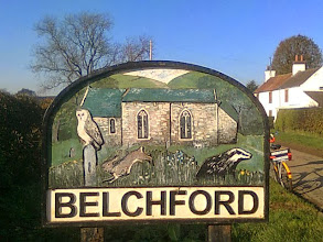 Photo: The south approach sign to Belchford with owl hare and badger outside a Saxon chapel.