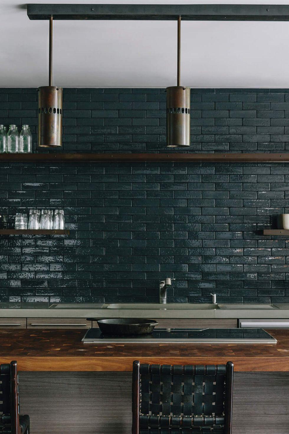 modern kitchen design featuring emerald green subway tile backsplash, minimalist style, large center island and open shelving